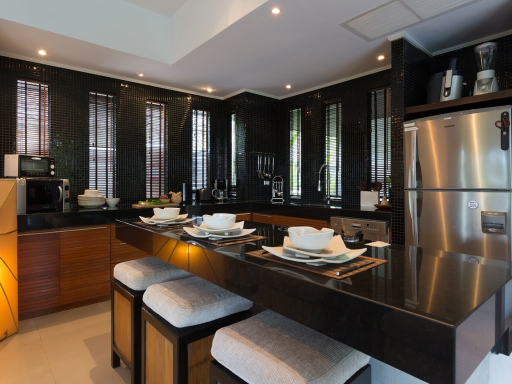 The Kitchen with a plethora of gourmet gadgets.